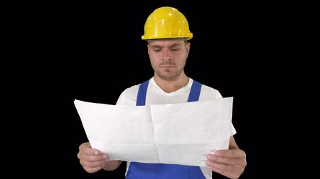 obnova : Engineer or Architect or Construction Worker holding blueprint and looking in the result of the work, Alpha Channel Dostupné videozáznamy