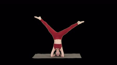 fiatalos : Woman performing a headstand with split, Alpha Channel Stock mozgókép