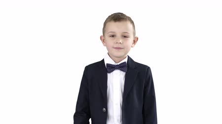 saudação : Boy in a suit greeting you Walks in and out on white background. Vídeos