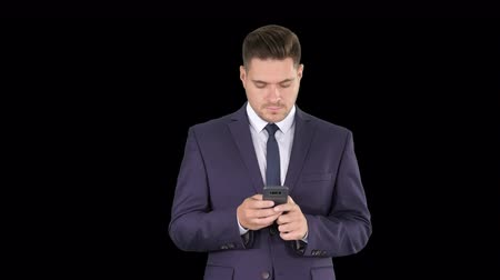 alpha cell : Businessman texting message on the phone, Alpha Channel
