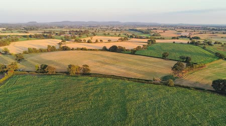 chester : Aerial view, slow panning move. Panoramic view on cheshire plains and fields.
