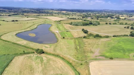 chester : Aerial view, pan move. Drone panorama of plains and small ponds hidden between fields