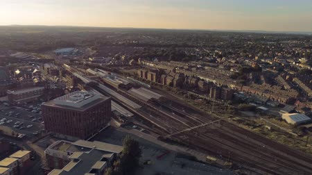 chester : Aerial view, pan move. Drone panorama of Chester city during sunset, railways station, housing estate
