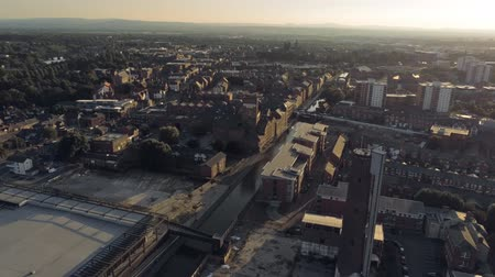 stare miasto : Aerial view, pan move. Drone panorama of Chester city during sunset close to canal, old shot tower and steam mill