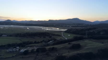 calming down : Aerial view, down move. Drone panorama sunset over Dwyryd river, hills in background in North Wales