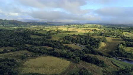 telített : Aerial view, fly down move. Drone panorama of green hills near Llyn Celyn water reservoir in Wales. Traweryn river