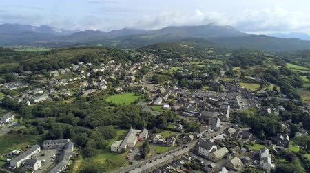yüksek ova : Aerial view, pan move. Drone panorama of Penrhyndeudraeth town in Snowdonia mountains in Wales