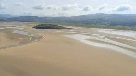 yüksek ova : Aerial view, panning move. Drone panorama of island on sea and sand in Snowdonia mountains in North Wales
