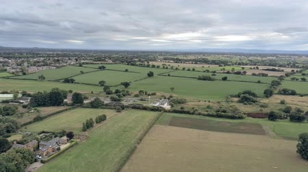 sheep pig : Aerial view, down move. Sewage treatment plant, houses among fields on Cheshire countryside