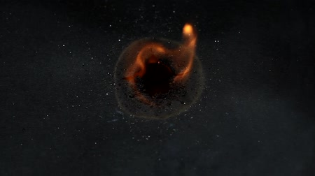 black dirt : Burned hole on a black paper background Stock Footage