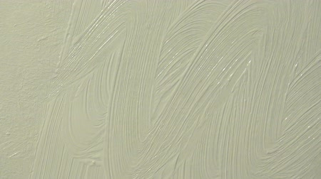 Wavy motion of the brush with white paint, construction and deco