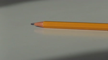 wooden pencil taken from a white office Desk Dostupné videozáznamy