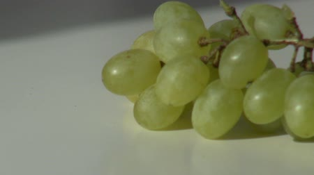brush green grapes put on a white table