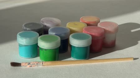 takes : Hand takes, opens and puts jar blue Acrylic gouache paint. Homew Stock Footage
