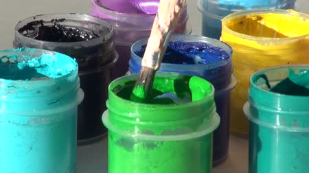 dips : brush immersed in a jar of light green Acrylic gouache paint Stock Footage