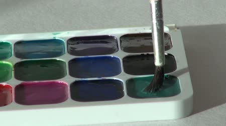paintbox : green color. close up. Artist works with brush and watercolor pa Stock Footage