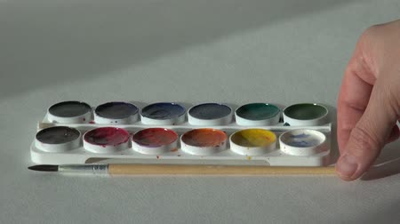 paintbox : artist works with paint on the table