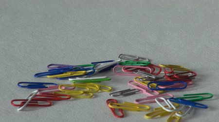 stationary : many paper clips office supplies