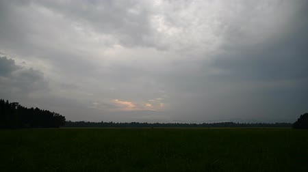 time laps : Time lapse of evening cloudy sky over spring fields.
