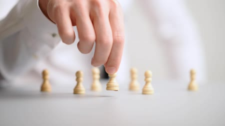 estratégico : Video of businessman placing chess piece of pawn in front of the others forming a pyramid shape. Stock Footage