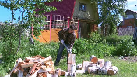 chock : Man cut firewood at their summer cottage