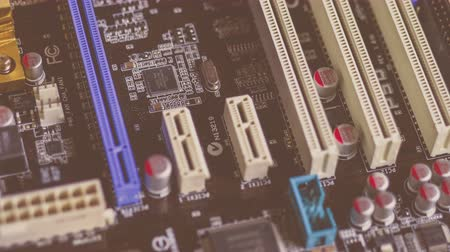 chip and pin : A series of 4K close up, slider shots of the surface of computer hardware parts. Chip, motherboard, curcuits, 4K 3840 x 2160 ultra high definition footage Stock Footage