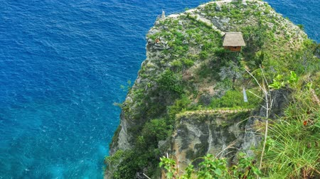 points of interest : Hut and View point on the cliff edge in the North Coast of Nusa Penida, Bali, Indonesia Stock Footage