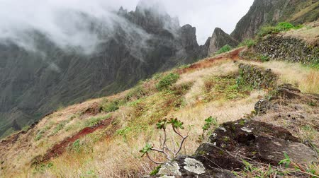 verdant : Fog flowing over their edges of mountain peaks. Amazing mountain scenery in Xo-Xo Valley. Santo Antao Island, Cape Verde Cabo Verde 4k video