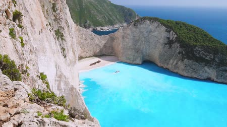 zante : Slow motion HD aerial view of amazing turquoise Navagio beach. holiday in paradise, seascape, vacation, trip, paradise concept. On sunny summer day. Zakynthos, Zante, Greece
