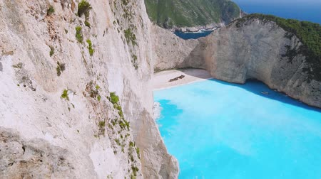 zakynthos : Slow motion HD aerial view of amazing turquoise Navagio beach. holiday in paradise, seascape, vacation, trip, paradise concept. On sunny summer day. Zakinthos, Zante, Greece