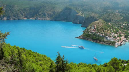 most : 4k video of popular tourist place Assos village on Kefalonia Island. Surrounded by lush greenery, clear blue water, Byzantine monasteries. Picturesque scenic coastline