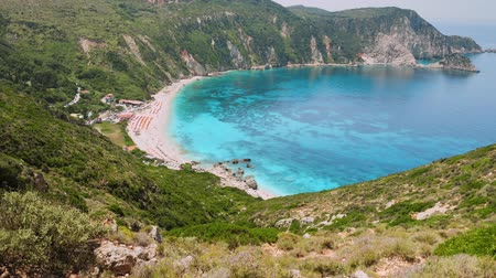 4k video of incredible beaches on Kefalonia Island. Mountains with lush greenery surrounding petani beach. clear blue water, picturesque scenic coastlines must-see destination