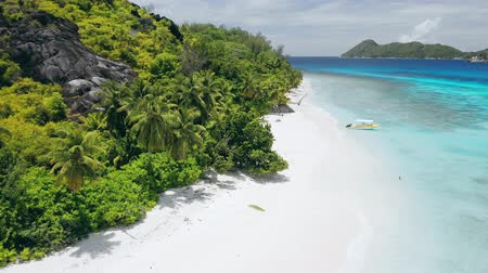 mahe : Aerial drone 4k footage of tropical paradise beach with perfect white sand and turquoise lagoon water. Summer vacation concept.