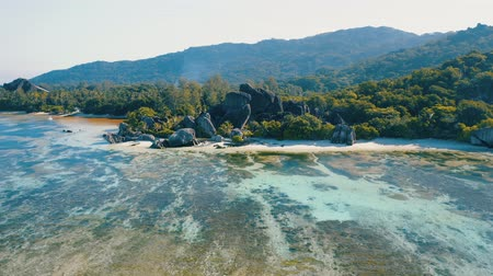Aerial view 4k footage to the most famous Anse Source Dargent beach on La Digue island, Seychelles. Picturesque shore line