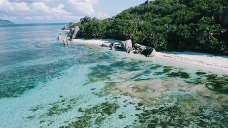 Aerial drone 4k footage along picturesque seaside of Anse Source Dargent beach on La Digue island, Seychelles