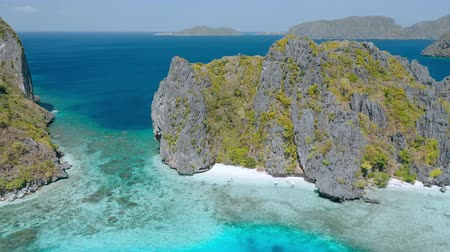 Aerial drone footage of Shimizu Island in El Nido, Palawan, Philippines. Rocks and crystal clear shallow turquiose lagoon water in front of the island Stock Footage