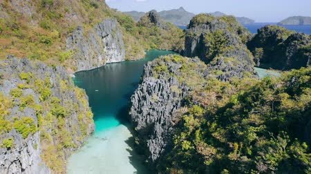 Aerial footage of big lagoon with sharp rocks and clear blue water in El-Nido, Palawan. Philippines. Unique spot on tour A island hopping trip