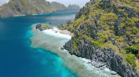 Star beach on Tapiutan island near Matinloc shrine. El Nido, Palawan, Philippines. Beautiful Landscape with Limestone rocks, paradise like beaches and coral reef edge