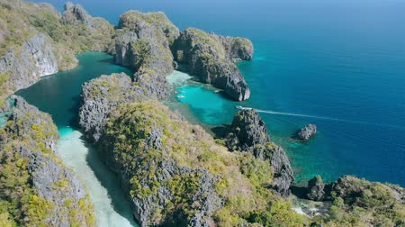 Aerial view of big and small lagoon on amazing Miniloc Island. El-Nido, Palawan. Philippines. Limestone rock formation and blue shallow water made this place unique to be seen on tour A Stock mozgókép