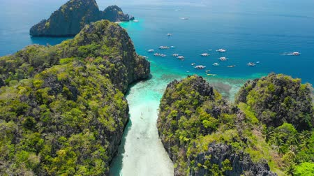 Entrance into the Big Lagoon, El Nido, Palawan, Philippines. Drone aerial fly over limestone cliffs and blue shallow water. Most visited Island Hopping Tour A