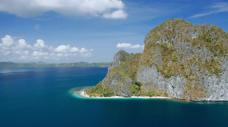 Aerial circle footage around breathtaking Pinagbuyutan Island. El Nido, Palawan, Philippines. Paradise tropical Ipil Beach with turquoise sea water and coconut palm trees Stock Footage