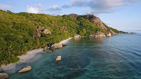 отступление : Aerial footage of famous tropical beach Anse Source dArgent at sunset evening light. La Digue Island, Seychelles