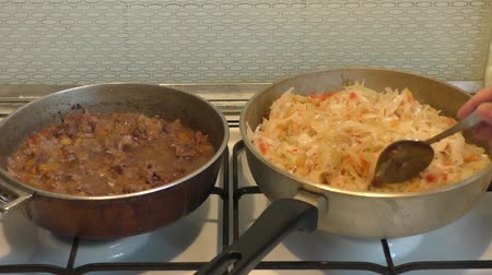 kavurma : Woman prepares braised cabbage and goulash