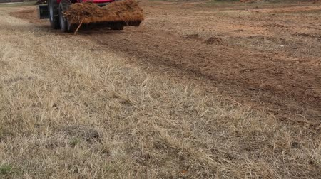 hidrolik : Red tractor passing by with a front end loader full of dirt. Stok Video