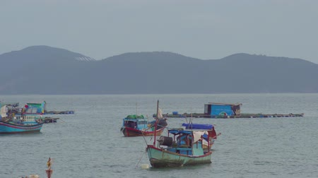 atracação : Vietnamese boats in a sea sunset. Nha Trang, Vietnam travel landscape and destinations. Stock Footage