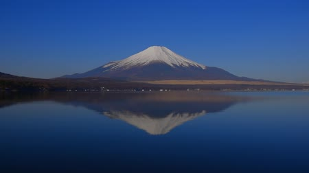 inverted : Inverted image of Mt.Fuji of Blue Sky clear weather from Lake Yamanakako Japan 03  14  2018 Stock Footage