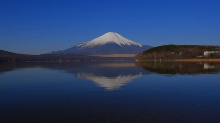 fujiyama : Inverted image of Mt.Fuji of Blue Sky clear weather from Lake Yamanakako Hirano Japan 03  14  2018 Stock Footage