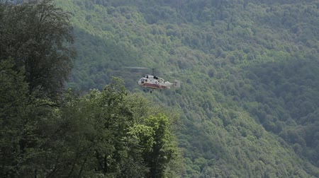 takeoff area : Helicopter in flight, mountains