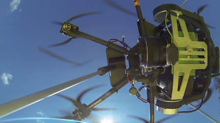 mainstream : quadrocopter takes off in the field, out of sigh Stock Footage