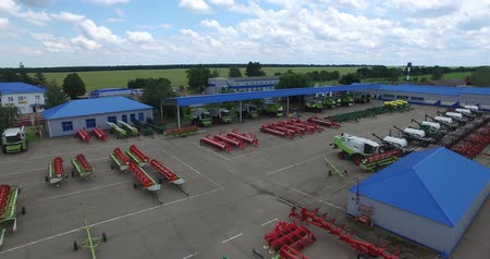kombajn : on the concrete area is agricultural machinery